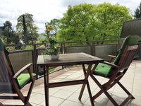 Balkonzimmer mit Gartenblick